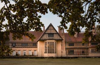 Sicht auf das Schloss Cecilienhof von der Seeseite, Foto: André Stiebitz, Lizenz: PMSG/SPSG